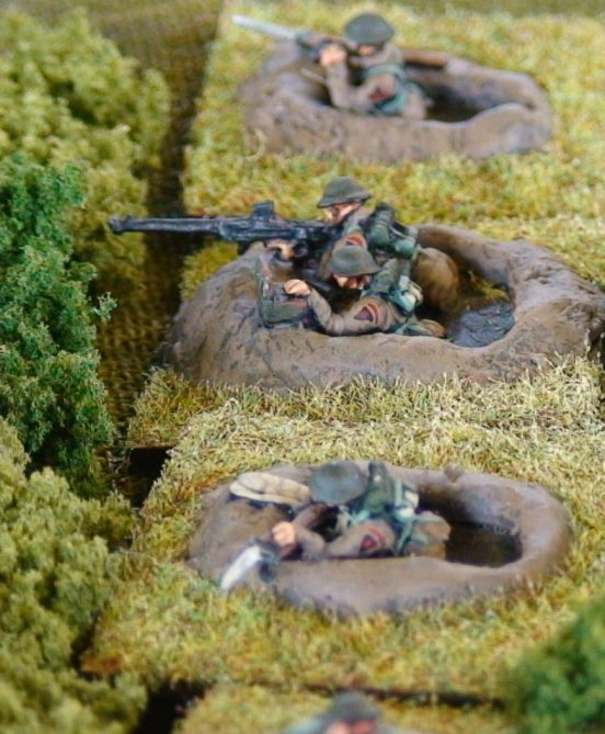 2 Riflemen (different poses) aiming/firing rifles from a