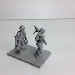 2 infantry advancing with Lewis gun, one carrying over shoulder,